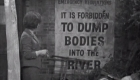 It is forbidden to dump bodies into the river sign