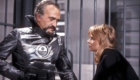 Roger Delgado in his last appearance as the master holds companion Jo Grant at gunpoint