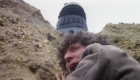 tom-baker-fourth-hangs-from-cliff-while-dalek-nazguls-above-destiny-of-the-daleks-doctor-who-back-when